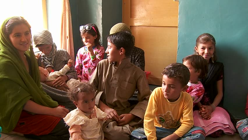 KABUL, AFGHANISTAN - CIRCA 2009: A family gathering  circa 2009 in Kabil, Afghanistan. Afghanistan is an impoverished and least developed country, one of the world's poorest.