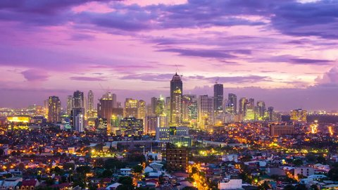 Manila city at Twilight showing Bonafacio Global City, Ortigas and suburban buildings in the foreground and a lightning storm active