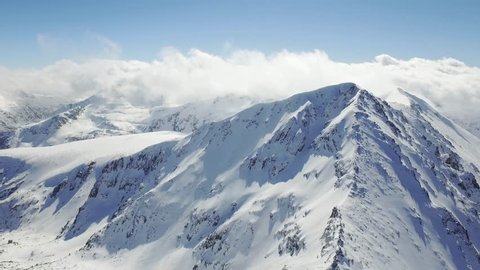 Drone Aerial Flight Over Mountain Peaks Sun Shining Morning Mist Beautiful Swiss Range Epic Scale Landscape Winter Holiday Fairy Tale Vacation Concept UHD 4K