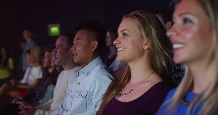 4K Young theatre audience give a standing ovation to the performers on stage | Shutterstock HD Video #15122299
