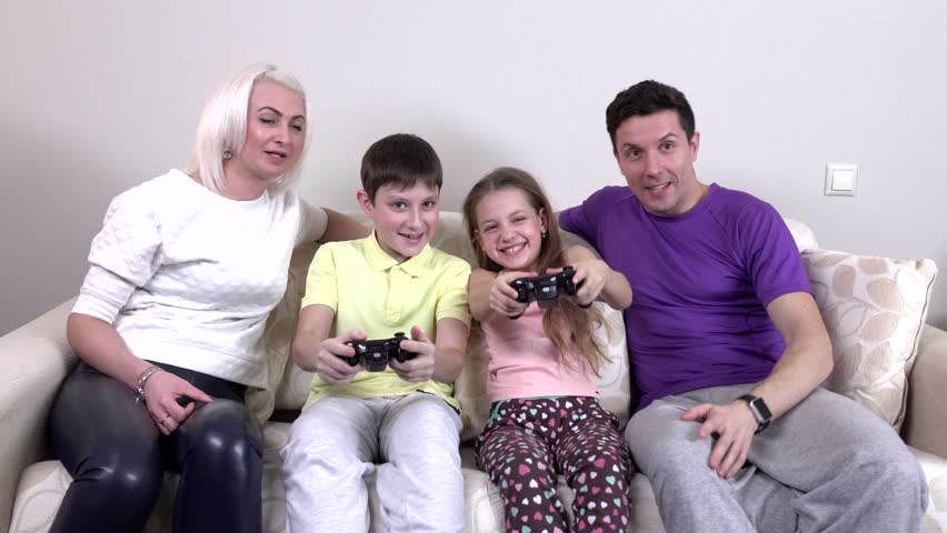 Family Playing Video Games In The Living Room Slowmotion Stock