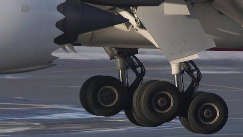 HUGE AIRPLANE DETAIL LANDING GEAR TOUCHDOWN - CA DECEMBER 2016: airplane landing on runway close up of gear touchdown