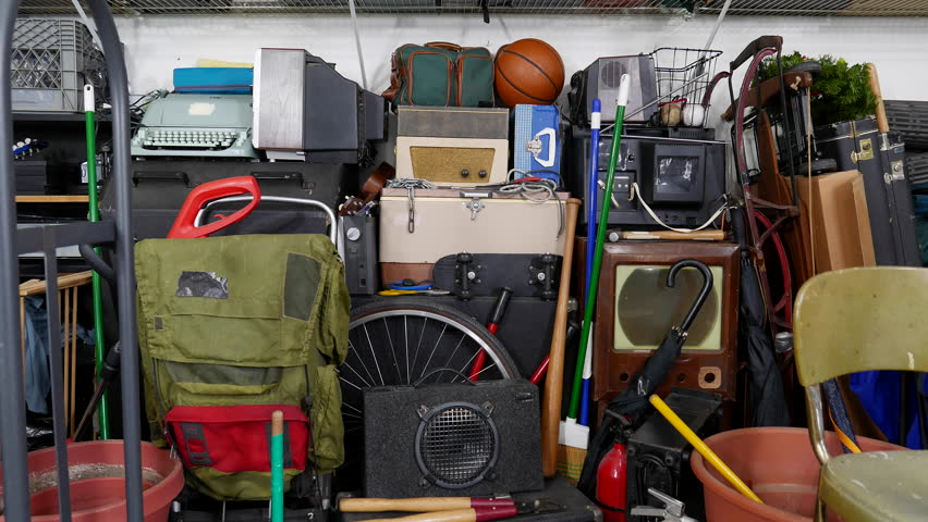 Vintage rummage filled garage dolly out shot.  Object brand names and logos were covered.   | Shutterstock HD Video #15145474