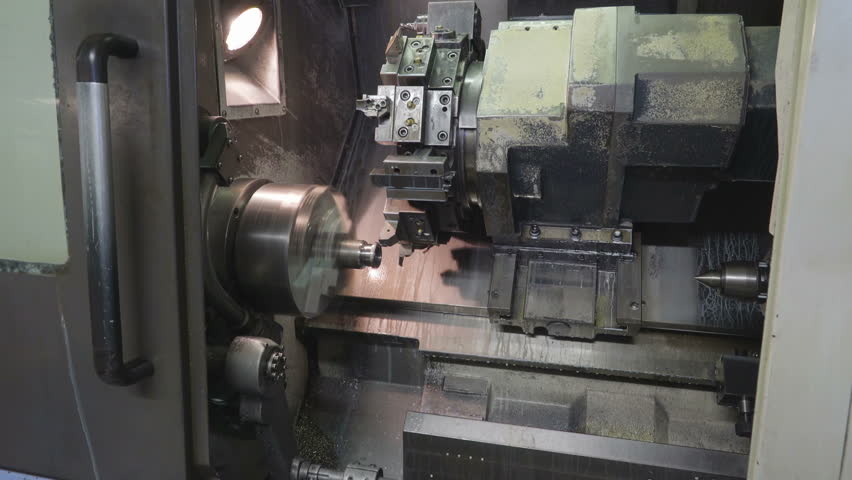 A big machine scraper on the works scraping the side of a metal tube from a another machine   Shutterstock HD Video #15167704