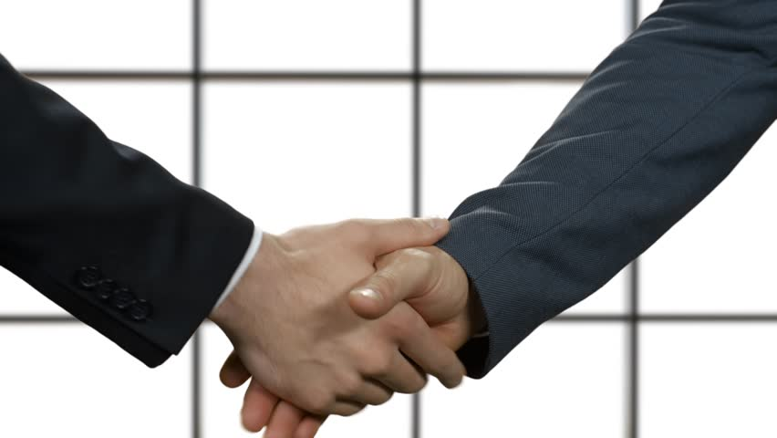 Politics shake hands. Don't believe what you see. Act natural. Concealed lies. | Shutterstock HD Video #15178828