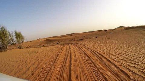 4x4 off road land vehicle taking tourists on desert dune bashing safari, Middle East