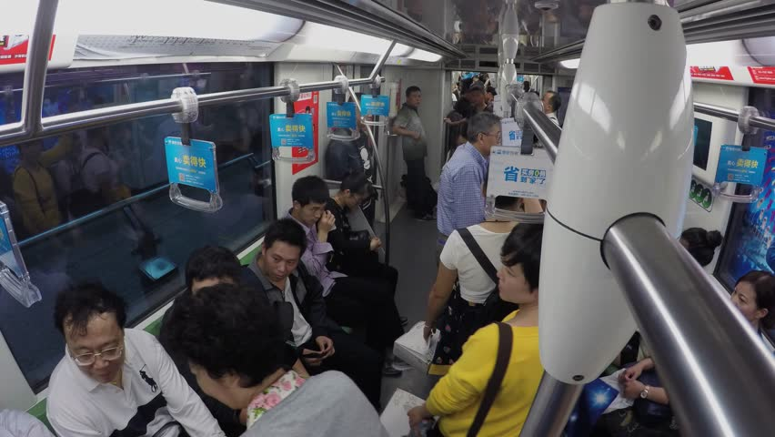 SHANGHAI - NOV 07, 2015: Many people ride in metro train by tunnel with commercial banners. Timelapse | Shutterstock HD Video #15191794
