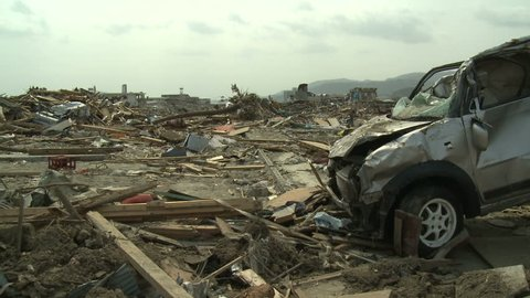 Japan Tsunami Aftermath - Destroyed Car In Remains Of Downtown Rikuzentakata City - Full HD 1920x1080 30p.