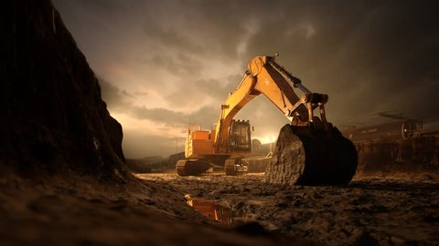 02566 Excavator Machine With Big Shovel On Construction Site Against Dramatic Sky