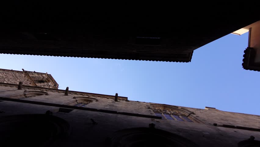 Look Up At Narrow Dark Lane Old Gothic Buildings Water Drip From Gargoyle