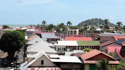 Panning shot of red roofs in downtown Cayenne French Guiana.