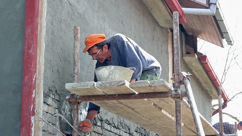 Construction Worker Leveling Cement Render. Sand And Cement ...