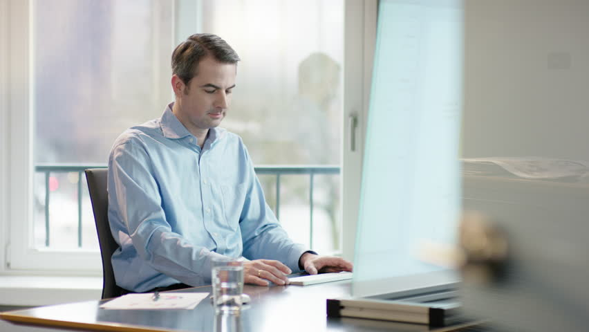 Business man at office desk making the right descision   Shutterstock HD Video #15255289