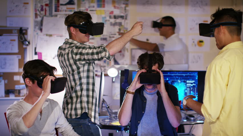 4K Group of young male computer gamers immersed in a virtual reality game   Shutterstock HD Video #15294814
