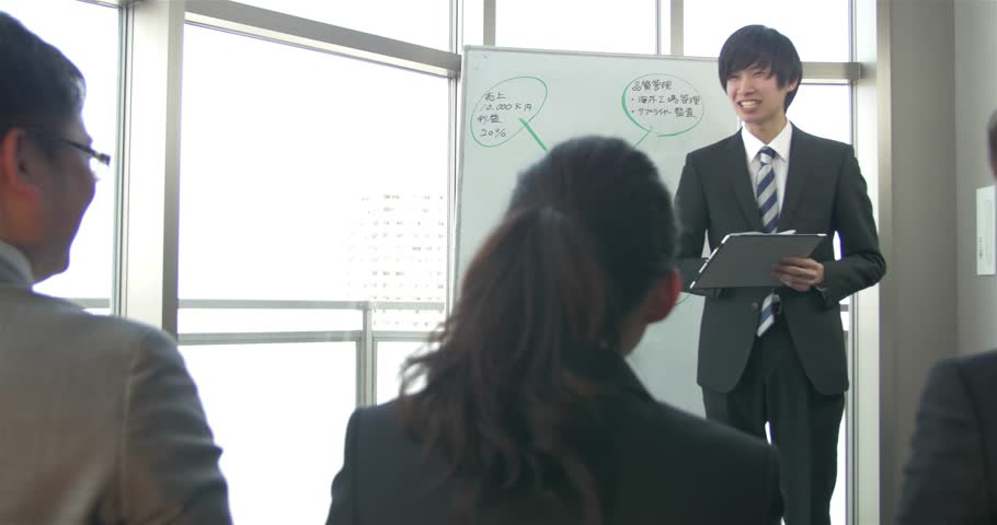 Young Japanese businessman makes a presentation to the team    Shutterstock HD Video #15318934