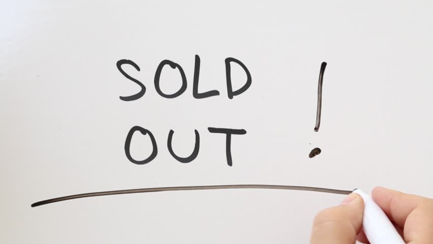 Shot of Sold Out written on whiteboard