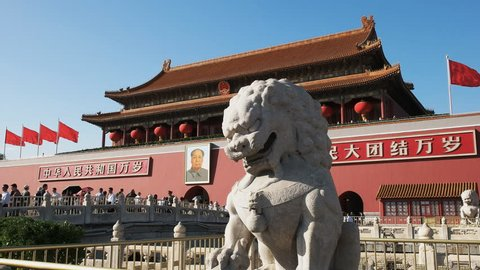 BEIJING, CHINA- OCTOBER 2, 2015: close up of an ancient stone lion at the entrance to the forbidden city at tiananmen square, beijing