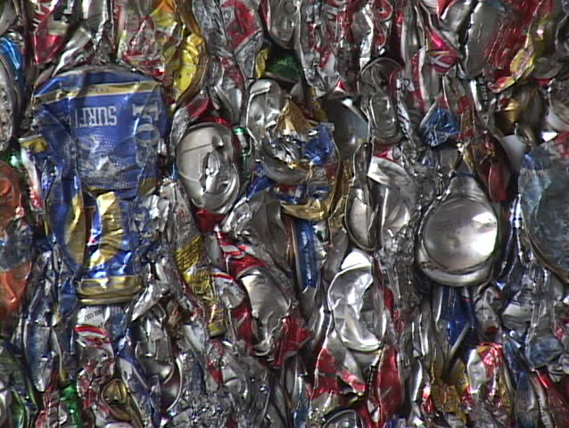 SANTA BARBARA, CA - CIRCA 2009: Blocks of aluminum cans get stacked at a recycling center circa 2009 in Santa Barbara.