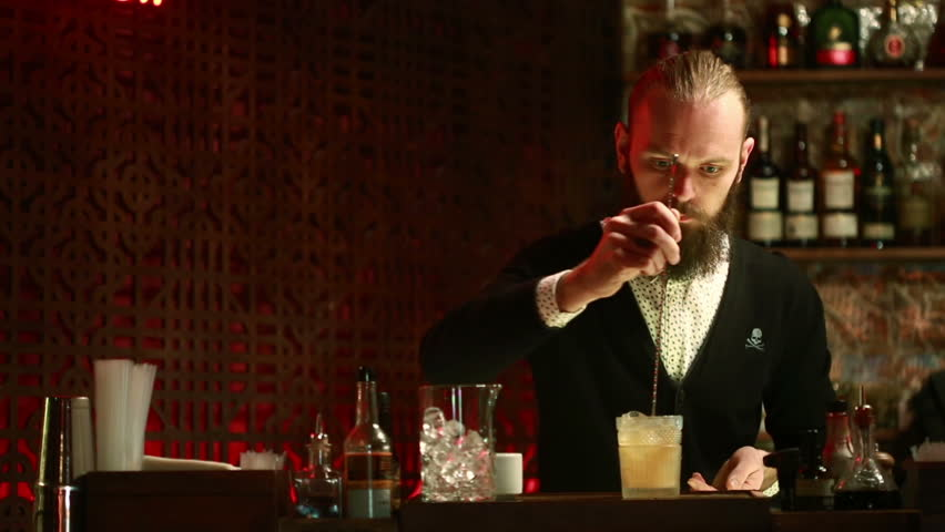 Handsome barman professional at posh bar making cocktail drinks #15359701
