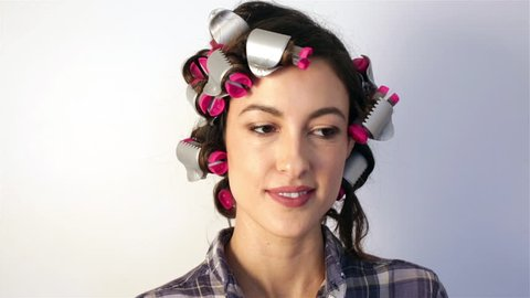 Pretty Young Woman in Hair Roller Curlers Making Silly Faces and Dancing
