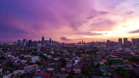 Zoom out timelapse of twilight over Metro Manila transitioning to night, Philippines