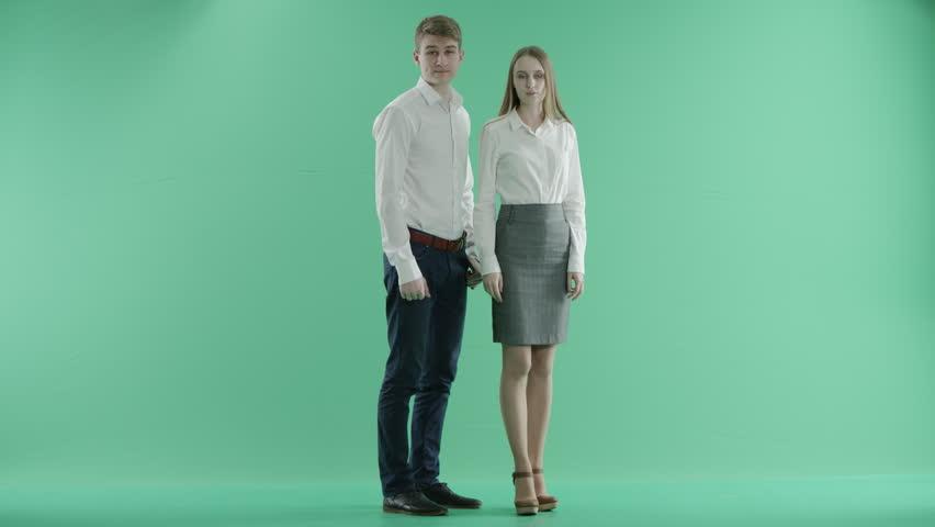 Businessman and businesswoman show gesture sucks    Shutterstock HD Video #15391414