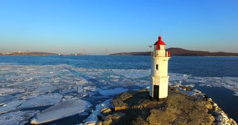Aerial winter view of the Tokarevskiy lighthouse - one of the oldest lighthouses in the Far East, still an important navigational structure and popular attractions of Vladivostok city, Russia.