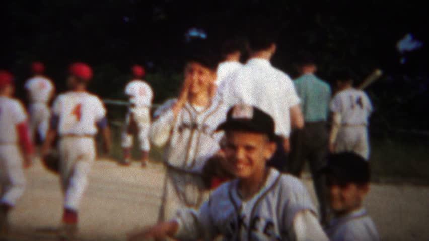 DAYTON, OHIO 1964: Little league baseball boys team yankees leaving field.