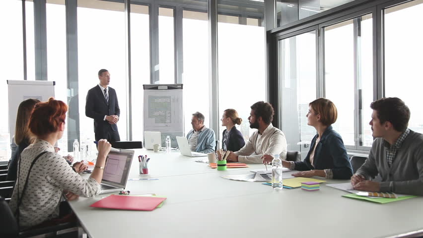 Colleagues applauding director during a meeting in conference room | Shutterstock HD Video #15414634