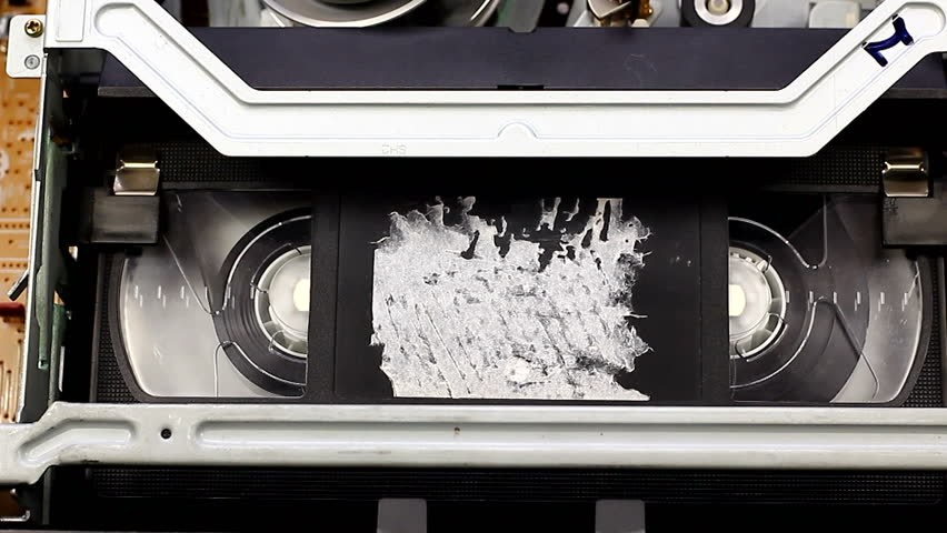 Playing video cassette on VCR VHS | Shutterstock HD Video #15430474