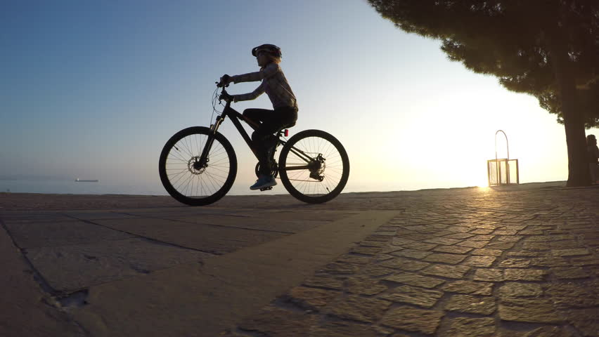 Cycling at sunset on beach