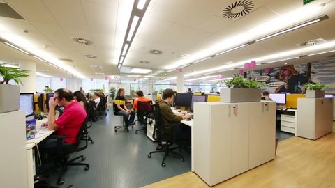 MOSCOW - JUN 03, 2015: People work in office. Tinkoff Credit Systems is first Russian bank that has completely refused from branch of bank