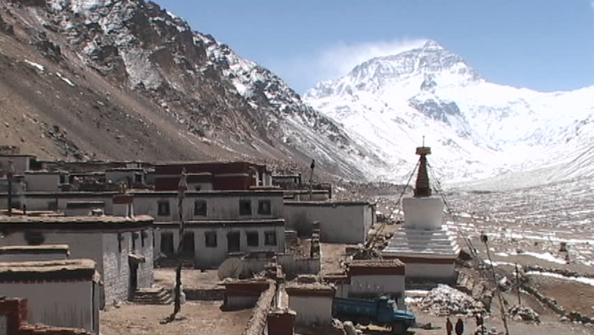 Wide view of entire Rongbuk Monastery with Mt. Everest in the background