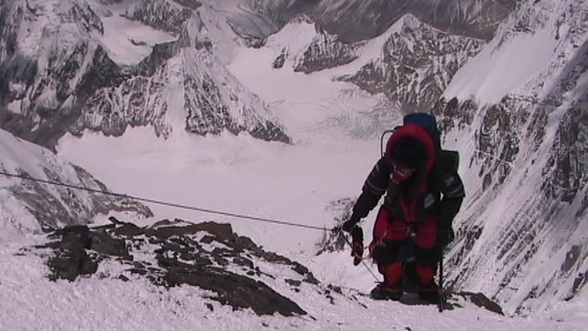 In the death zone climbing towards the summit of Everest - Climbers navigate difficult terrain