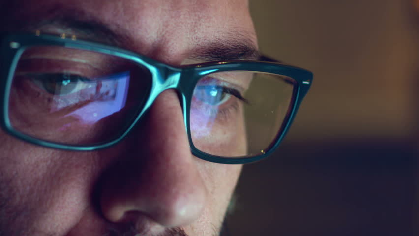 Creative Mature Adult Man Chatting Browsing at late night  - Close Up shot with Display Glasses Reflection