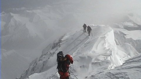 Climbers coming down from the summit of Everest over extremely exposed area