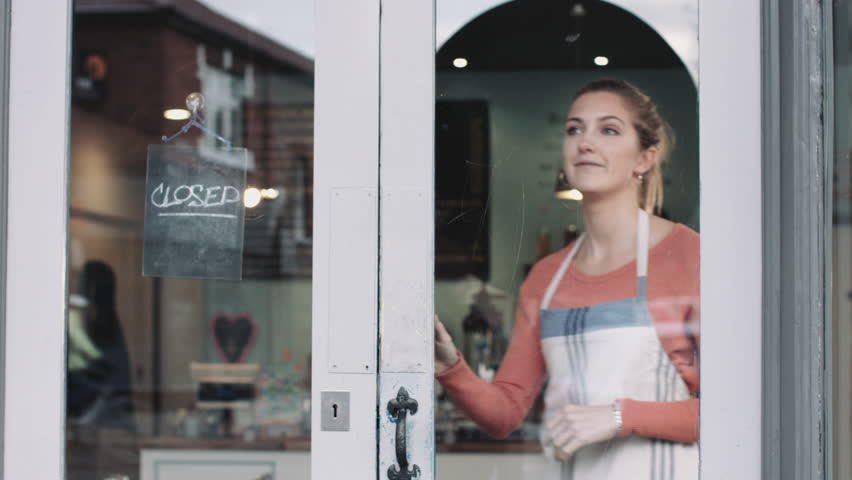 Small business owner opening shop | Shutterstock HD Video #15496948
