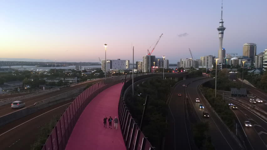 AUCKLAND - MAR 27 2016:Timplapse of bright pink cycleway and Auckland skyline.The cycleway inner city cycling and pedestrians network is New Zealand's biggest urban cycling infrastructure ever built | Shutterstock HD Video #15504154