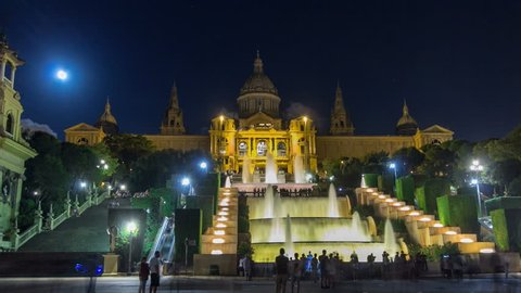 Famous light show and magic fountains timelapse hyperlapse in front of the National Art Museum at Placa Espanya in Barcelona at night, Catalonia, Spain