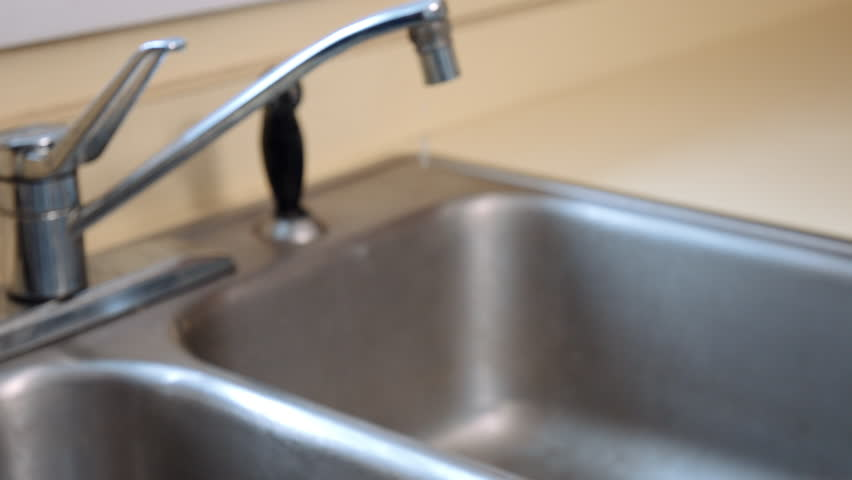Rack Focus To Closeup Of Old Dripping Kitchen Faucet. Racks Focus ...