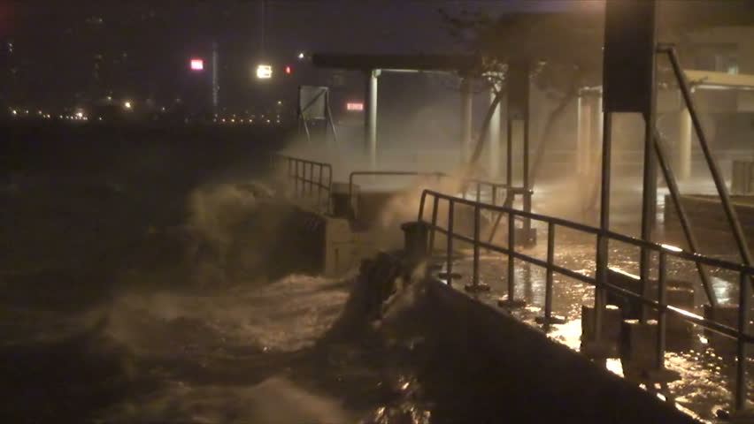 Waves Crash Into City Seawall As Hurricane Hits