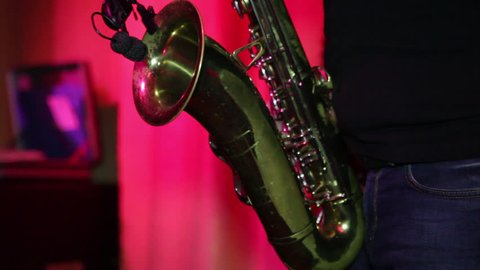 Musician Plays the Saxophone on the Concert Platform. Shot on Camera Canon 5d Mark 2