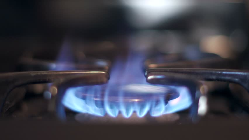Stove top burner igniting into a blue cooking flame in 4K UHD. See my portfolio for other angles and slow motion speeds (60fps-180fps).