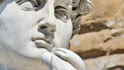 Detail close-up of Michelangelo's David statue  with place for your design or text and  motion video camera up