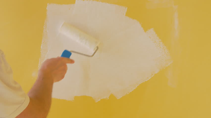 Young Man Paint Yellow Wall In White. Brush Or Roller With White ...