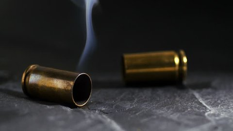 Smoking bullet case on ground