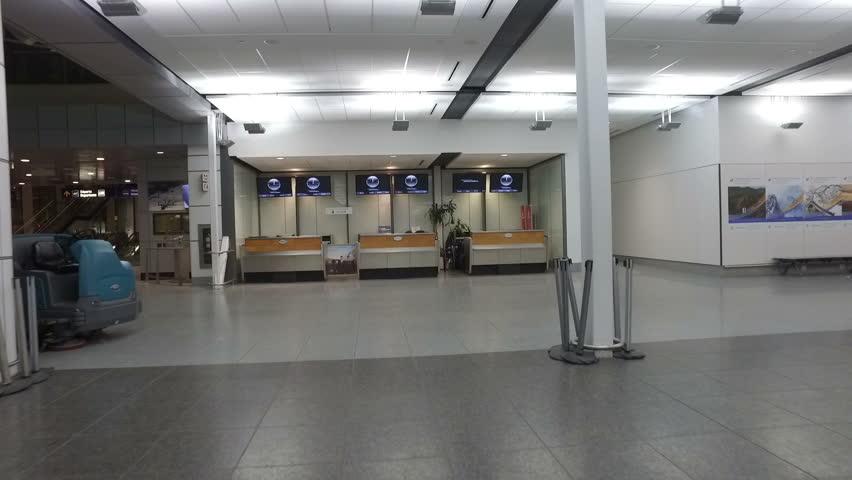 Garage Design Montreal: A Woman Walks Through A Dark Parking Garage By Herself