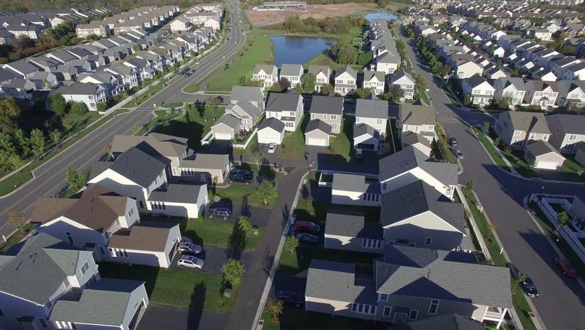 An aerial establishing shot of a suburban neighborhood, 4K UHD   Shutterstock HD Video #15624994