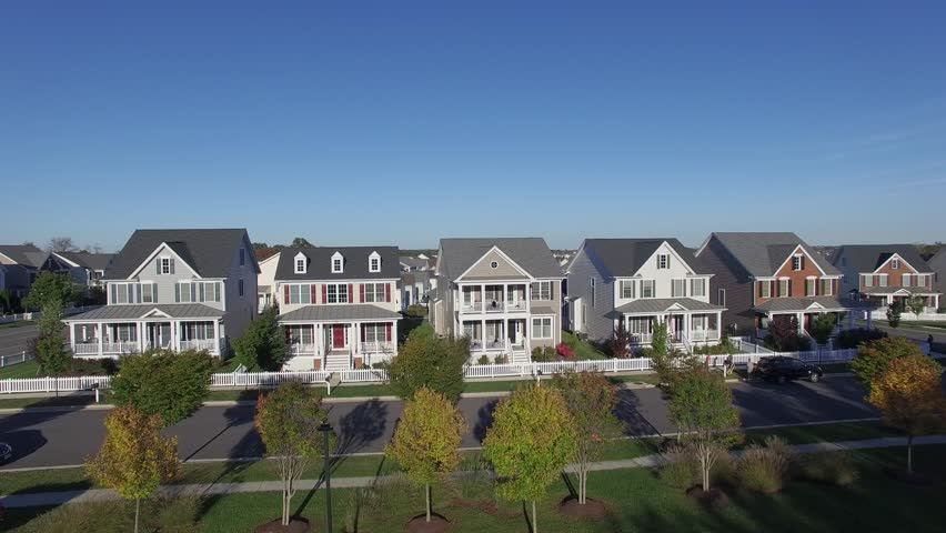 An aerial establishing shot of a suburban neighborhood, 4K UHD | Shutterstock HD Video #15624994