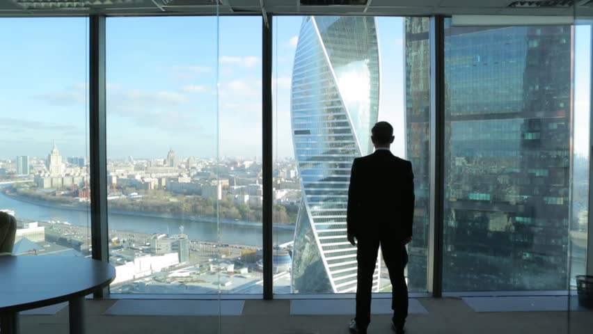A man from a skyscraper looking over the city, silhouette, dolly, | Shutterstock HD Video #15630664
